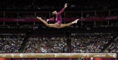 """Gabby Douglas' Beam Performance Gives Us The Defining Photo Of The London Olympics"" AP photo by Gregory Bull"