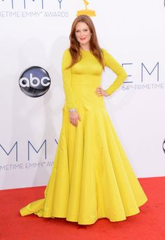 Emmys 2012: The Best of the Red Carpet - Julianne Moore makes a major statement in a canary yellow long-sleeve, full skirted gown by Christian Dior Couture by Raf Simons.