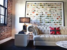 The framed pics / brick wall / that couch and throw pillow.