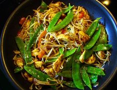 """Grainless Asian Stir Fry """"Noodles"""" 1 chopped onion 1/2 cup bean sprouts 2 carrots spiral sliced 2 zucchinis spiral sliced 1/2 cup sliced mushrooms 10 snow peas with ends trimmed"""