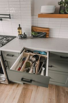 This custom DIY drawer organizer can transform a cluttered utensil drawer into an organized kitchen drawer of your dreams in a snap and won't slide around thanks to a simple hack. #DIY #DrawerOrganizer #KitchenDesign