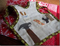 Love this cute boy bib.  I've still never made a babpron, but I love this pattern.