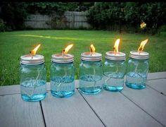 Mason jars. Cotton string. Liquid Citronella.  Now back off mosquitoes!