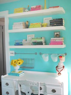 Like the colored wall with white shelves and desk