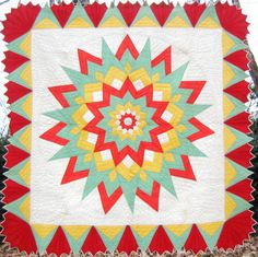 From southeastern PA, but designed by Hubert Ver Mehren of Iowa, this very art deco 1930's quilt features bright color and striking pattern - an eleven pointed starburst! In crisp, unused condition, it measures about 80 inches square.