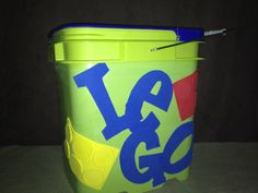 So here's my next Pintrest inspiration... again, I am not good at this crafty stuff...but It's an old container that the (fresh) cat litter came in. Spray painted, and cut out letters and Legos out of foam to give the kids someplace to keep all those damned Legos!