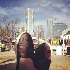 Kicking our feet up at SXSouthBites and loving the Austin skyline. #ourAustin #sxsw #kennethcole
