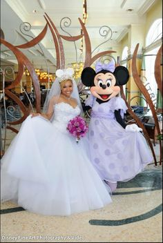 Aww!  Walt Disney Wedding Photo with Minnie Mouse!  Can she be one of the bridesmaids?? :)