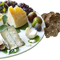Champagne grapes, fresh figs, Seckel pears, Bûcheron (or Brie), Humboldt Fog (or blue cheese), Farmstead Cheddar, Gorgonzola dolce, herb-covered goat cheese