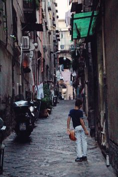 neapolitan boy playing ball in the alley way, napoli, italy, 2012 (digital)