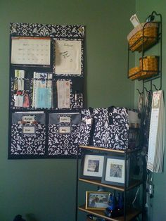 Hang-Up Home Organizer from Thirty-One. Love It! Lots of pockets for organizing and even a spot for a calendar!