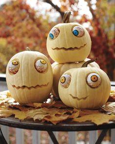 Zombie pumpkins for Halloween with plastic eyeballs. So fun!