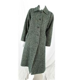 It may not be coat weather, but that doesn't mean you cant stock up for winter with this gorgeous Green Boucle Wool Coat! Get it here >>> http://bit.ly/1hJvAIC #1960s #vintage #fashion