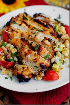 Grilled marinated chicken with corn salad.