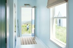 A skylit entry provides a taste of what's to come in the beautiful scenery a step outside the door. Shown here: Breath of Fresh Air 806 by Benjamin Moore. | Photo: Courtesy of Benjamin Moore | thisoldhouse.com graphic, bathroom colors, blue walls, paint colours, fresh air, kitchen colours, benjamin moore, kid bathrooms, color trends