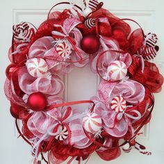 Peppermint Christmas Wreath Deco Mesh Christmas Wreath. $125.00, via Etsy.