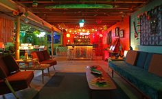 The basement of Joe and Heidi Kinder's Milwaukee ranch is decorated as a tiki room with bright colors and a bar made from an old dresser