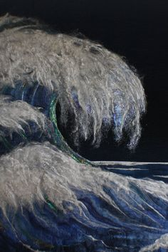 close up, Elements of Change by Joan Bielun. Blue ribbon award, National Juried Show 2013 ~ Canadian Quilters' Association.  The wave (made by the silk  fusion process and hand needle felting) has a base of bombyx silk sliver, natural silk in sericin, tussah silk noile, degummed  throwsters silk and angelina fibers. Photo by Janome Life