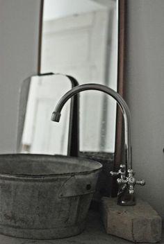 DIY: Galvanized Bucket as Bathroom Sink : Remodelista  http://remodelista.com/posts/diy-galvanized-bucket-as-bathroom-sink#
