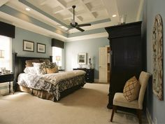 Bedroom color scheme- blue and warm beige with black and white accents.