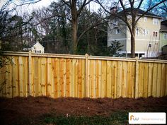 Board on board privacy fence with 4x4 posts, one fascia board and one top board. This fence is made from pressure treated pine lumber.