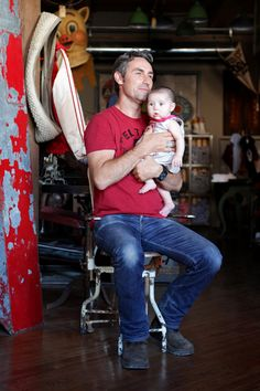 """Mike Wolfe of """"American Pickers"""" and his baby daughter Charlie in his new Antique Archaeology shop in Nashville"""