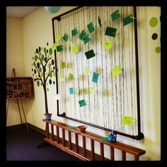 Prayer wall where parents & kids pray together at church. Love this