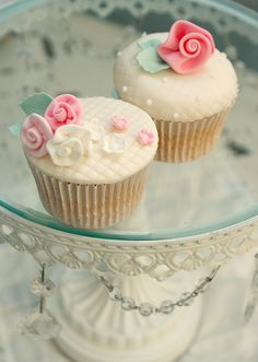Sweetly gorgeous little cream and pink hued floral topped cupcakes. #shabby #chic #cupcakes #food #wedding #roses #pink #flowers #baking #decorated #dessert