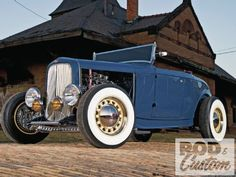 1932 Ford Roaster in front of a pretty amazing looking building