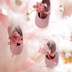 A Tree of Baby Shoes     Spread the theme of Baby's First Christmas to your tree with baby-shoe ornaments embellished with tiny satin flowers. They're easy to make and add the sweetest addition to your holiday decor