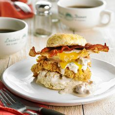 Flaky homemade biscuits sandwich tender fried eggs, fried chicken, and crispy bacon for a hearty and irresistible morning stack-up: http://www.bhg.com/recipes/breakfast/brunch/brunch-recipe-ideas/?socsrc=bhgpin102214heartbreakfaststacks&page=7