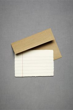 Be sure to write within the lines of this elementary, straight stitched set. Set of 10 cards and envelopes. Paper, cotton thread. Handmade in Canada.
