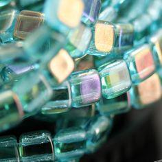 Wow. LOVE this color(s)! 25 Aquamarine twilight Czechmates, two hole glass tile beads. www.stinkydogbeads.com