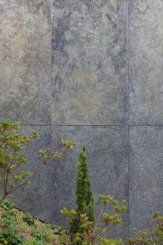Galvanised steel facade of two houses in Oberweningen, Switzerland by L3P Architekten