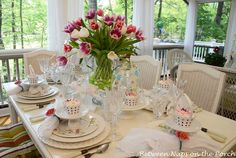http://betweennapsontheporch.blogspot.com/2012/04/easter-table-setting-with-tulip.html