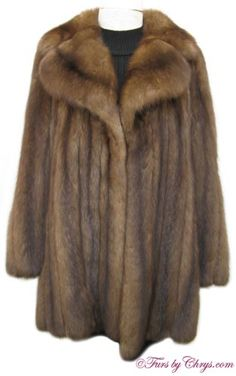 "Russian Sable Stroller Jacket #RS649; Excellent Condition; Size range: Misses 8 - 12; Price Reduction! $9,000.00. This is a gorgeous genuine natural Russian sable fur jacket in the versatile stroller length. It has a Azens Furs label and features a very full and large notched collar, straight sleeves, and 7"" side slits. It is very lightweight, yet warm, and it drapes beautifully. Your purchase will be accompanied by a copy of an appraisal. This Russian sable stroller coat is a fantastic value!"