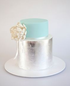 Cake by Sweet Tiers // http://blog.theknot.com/2013/09/05/glamorous-metallic-wedding-cakes/