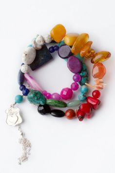 Rainbow, semi precious stones, gypsy, boho, sterling silver, turquoise, amber, lapis, $149 from www.spelldesigns.com bracelet, cuff, color, birthdays, amber, sterling silver, stone, rainbow, black