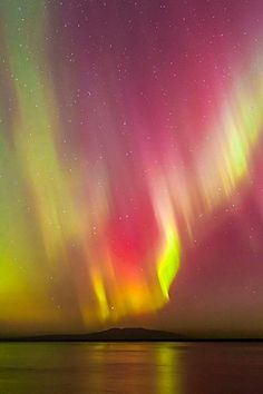 flitterling: Northern Lights, Alaska, by Carl Johnson. Wow! Some very unusual colors in there.