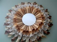 Wreath made from sheet music, craft paper, doilies, and a mirror.