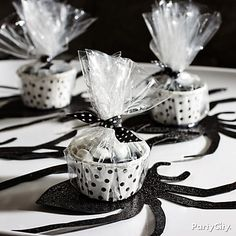Candy cups + spider paper cutouts = eeek! Make their skin crawl with a DIY black-n-bone Halloween candy buffet!