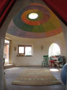 Inside an earthbag home. Love that ceiling!!