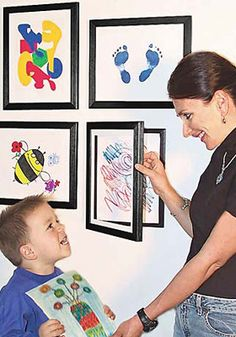 Cute way to hang artwork that your kids have done...so easy to change it