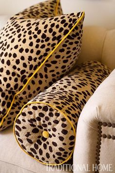 """Printed """"Ocelot"""" pillows with yellow trim add pizazz to the couch. - Traditional Home ® / Photo: John Bessler / Design: Philip La Bossiere"""