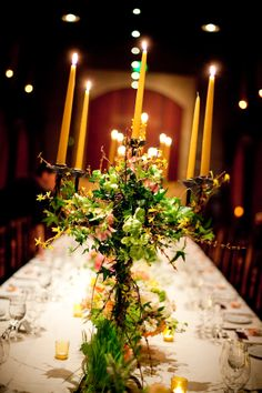 Think the wrapping of flowers around candelabra could be interesting.#NVCE Candelabra Centerpiece