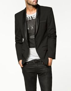 A good look for a casual event.. I like the narrow satin shawl cut of this jacket paired w/ a cool T.  It works!