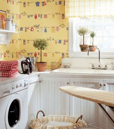 We should make more laundry rooms a fun place to be.  Thibaut wallpaper.