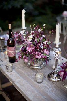 wedding tables, table settings, rustic table, centerpiec, mercury glass, candle holders, purple flowers, wine bottles, plum