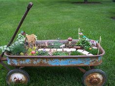 Fairy Garden in an old rusty wagon! They'd wreck this right away and drag all the pieces across the yard, but in a perfect world, this would be so cute.
