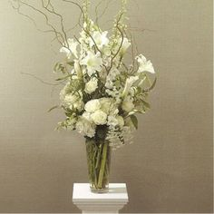 Flower Arrangements For Church Altar | ... and decorative grasses give a larger feel to this altar arrangement
